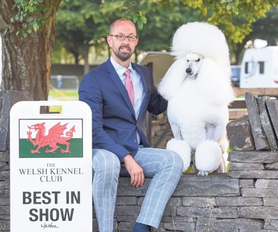 Jason Lynn pictured with the Afterglow kennel's latest Best in Show winner, Ch Afterglow Poppa Don't Preach co-owned with Tom Isherwood. Grace is the glorious Poodle (Standard) who took the prestigious award at the Welsh Kennel Club under Jonathan Daltrey (Bananadance) last weekend.